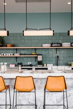 Kitchen with sage blue backsplash tile, marble island and leather stool with . - Kitchen with sage blue backsplash tile, marble island and leather stool with … -