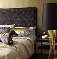 Make a gold statement with a wall of tactile wallpaper. Match with gleaming accessories, then add subtle tones and let texture do the talking.