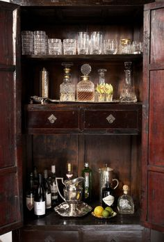 handsome bar featuring decanters and vintage glasses