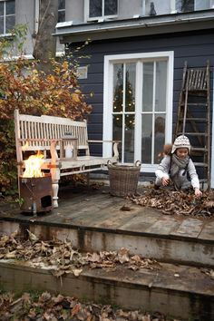 Autumn back porch with a portable burn barrel.