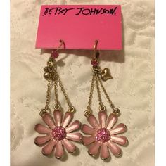 Pink daisy dangle earrings  Beautiful pink daisy earrings. Gold color hardware with pink stone accent. Jewelry Earrings