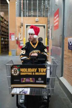 Bruins Holiday Toy Shopping 2015 - 11/17/2015 - On Monday, - #88 David Pastrnak - the Bruins stopped by Target in Everett, Mass., to shop for toys which will be delivered to Boston-area hospitals in December. (Kenneth So)