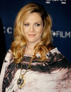 Love her makeup and look: Drew Barrymore had a head full of voluminous curls on the LACMA red carpet. Her warm makeup palette matched her strawberry blond hair perfectly. Perhaps, her stunning complexion is due to her pregnancy glow?