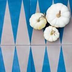 Happy Friday before Halloween! We are having fun dressing up our cement tiles with pumpkins. Because why not?