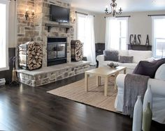 wood floor against stone fireplace | Dark Gray Wood Floors and stone, wood burning ... | living rooms + ot ...