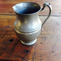"""Pewter Pitcher 60.00  A lovely Pewter Pitcher, looks perfect with our Pewter Candlesticks.    8""""H 7""""Diameter"""