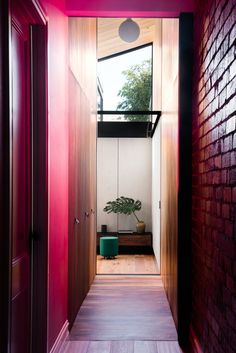 Home to architect Michael Artemenko, co-director of FIGR Architecture Studio—along with his wife Emma and their young daughter—this renovated heritage home in the Melbourne suburb of Cremorne uses a portal-like corridor painted a vibrant pink to connect the original period home to a new wing. #dwell #howtodesignwithpink #pinkdecorideas #interiordesign #moderndesign #pink Light Architecture, Architecture Design, Dusty Pink Bedroom, Melbourne Suburbs, Cement Walls, Pink Tiles, Blue Backsplash, Loft, Victorian Cottage