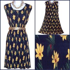 Dark Blue Pleated Fabric Dress with Yellow Flowers Wonderful little dress, wear with or without a belt (belt not included). Fabric is sheer but not see through. Length is just below the knee. No size tag but should fit a medium. Dresses