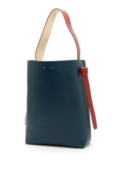 CELINE SMALL TWISTED CABAS BAG.  celine  bags  leather  hand bags   d6104d7d1bd60