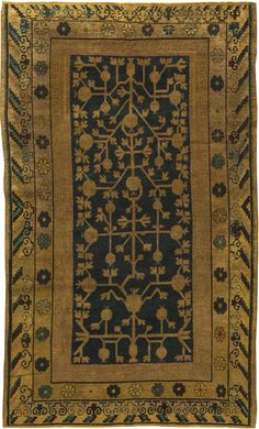 This circa-1930 vintage Samarkand rug features a striking narrow central design of botanical abstractions in warm beige against a field of midnight blue. Multiple borders in beige containing floral abstractions complete the look of the vintage carpet. The vintage Oriental carpets from Kashgar, Yarkand and Khotan in the Chinese occupied Autonomous Region of Sikiang are collectively known as Samarkands - lands of arid steppes, deserts and mountain ranges traversed for thousands of years by…