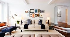 Neutral living room with concise gallery wall and navy accents