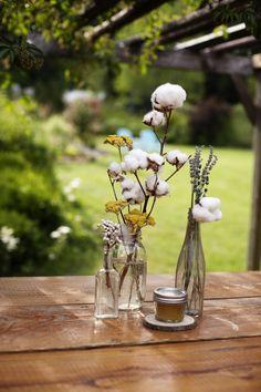 DIY cotton centerpiece. Read more http://applebrides.com/2013/11/27/diy-wedding-at-french-gulch-farm/