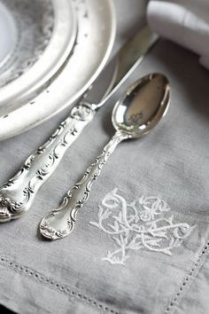 Grey table setting. Monogrammed linen napkin, silver fork and spoon. Very beautiful and classy!