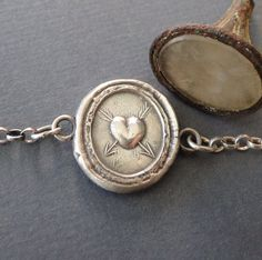 Lovestruck bracelet.. antique wax latter seal impression, sterling silver, various lengths. by SWALKDESIGNS on Etsy https://www.etsy.com/listing/215052177/lovestruck-bracelet-antique-wax-latter
