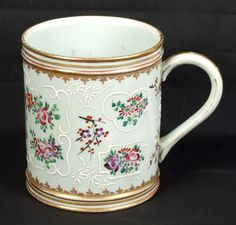 SAMSON ARMORIAL MUG. 19th c. large Samson porcelain armorial mug, Chinese Export style with hand painted polychrome and raised white enamel decoration, gilt bands and highlights. Marked: Samson (Asian marks).