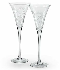 Marquis by Waterford Yours Truly Flute Pair by Waterford Crystal. $43.06. Each stands 11-1/4 inches tall. Set of 2 tall-stemmed toasting flutes. Marquis by Waterford affordable glassware. Romantic etched design of swirled vines and tiny hearts. Amazon.com                Toast to love or affection or simply to the joy of champagne with this pair of long-stemmed flutes. Each trumpet-shaped glass is etched with a romantic swirl of vines and tiny hearts. Add to this the extra-slende...