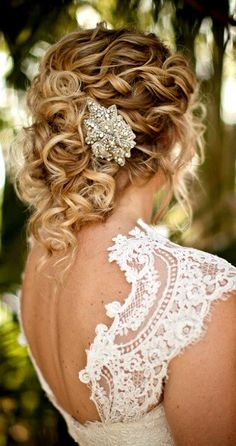 Bride's woven curls wedding hairstyle Swarovski pin