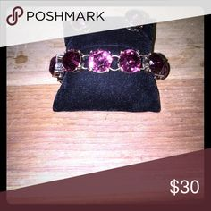 Crystal glass stones bracelet earring set Color is a light plum type color, could pass for a rose pink. New. Gold toned hardware Jewelry Bracelets