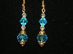 Handmade Teal Blue and Gold Crystal Earrings. $4.00, via Etsy.
