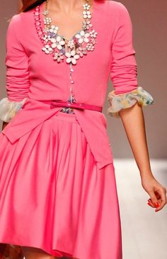 Pink on Pink- love! Repinned from lesleyevers.com - Love ruffled blouse under sweater & rhinestones!