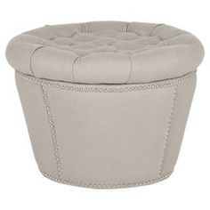 "Tufted storage ottoman with nailhead trim. Product: Storage ottomanConstruction Material: Plywood and fabricColor: TaupeFeatures: Nailhead detailDimensions: 15"" H x 22.5"" Diameter"