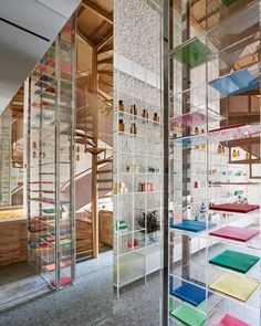 5ed5f6330 This drugstore by Taiwan studio Waterfrom includes greenery, glass shelves  and copper details designed to