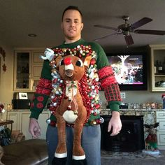 20 Hilarious Ugly Christmas Sweaters - Design Dazzle- you're a fan of DIY or you like to buy, this post has 20 hilarious ugly Christmas sweater ideas for anyone and everyone! Ugliest Christmas Sweater Ever, Cute Christmas Outfits, Diy Ugly Christmas Sweater, Ugly Sweater Party, Ugly Sweater Couple, Christmas Ideas, Diy Christmas Sweaters, Ugly Sweaters Diy, Ugly Christmas Tree