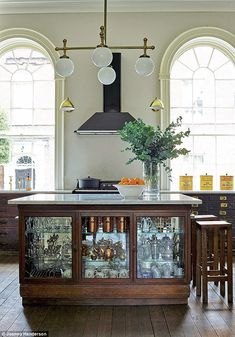 The kitchen island was built using two former shop counters from antique dealer Neville Fo...