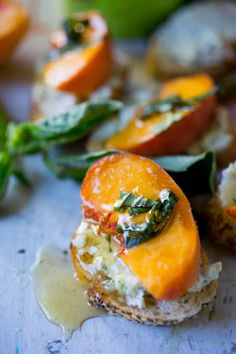 Peach Brushetta with goat cheese, basil and infused honey...a simple delicious appetizer you can make in minutes!  www.feastingathome.com