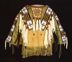 ate : 1989  Credit Line: Gift of Mr. and Mrs. Wiliam D. Weiss  Synopsis: shirt- man's- Southern Ute- Box, Austin- commercial- Beads- Buckskin- paint- dyes- ermine- glass- porcupine quills- sinew
