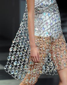 Prada: Spring 2010. This collection was based around creating garments out of jewels. #prada #jewels #iridescent