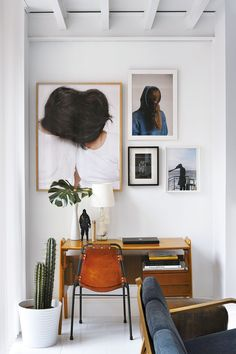The photographs in this gallery wall are so unique & organized in a super cool asymmetrical way. Great idea for thought-provoking office decor!