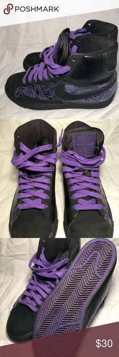 Nike sneakers All black Nike sneakers with cool purple design  Gently worn (Please review pictures)  Has a couple of dust marks, probably could be removed with a good cleaning Small white mark on back of right shoe sole (Shown in pics) Still great condition, lots of life left in them Nike Shoes Sneakers