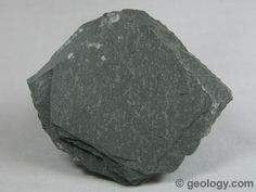 Slate is a foliated metamorphic rock that is formed through the metamorphism of shale. It is a low grade metamorphic rock that splits into thin pieces. The specimen shown above is about two inches (five centimeters) across.