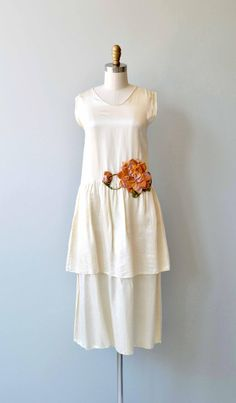 Antique 1920s cream silk dress with a matching silk scarf, a spray of peachy velvet flowers at the hip and a tiered skirt, a simple, unfussy fit with drop waist and no closures, easily slips on over the head. --- M E A S U R E M E N T S --- fits like: xs/small bust: best fit up to 32 waist: best fit up to 28 hip: best fit up to 40 length: 44 brand/maker: n/a condition: excellent to ensure a good fit, please read the sizing guide: http://www.etsy.com/shop/...