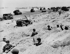 American soldiers of the Allied Expeditionary Force securing a beachhead during initial landing operations at Normandy, France, June (AP Photo/Weston Haynes, Powerful D-Day Photos On The Anniversary Of The Invasion Normandy Beach, D Day Normandy, Normandy France, Normandy Ww2, D Day Photos, D Day Invasion, Normandy Invasion, D Day Landings, American Soldiers