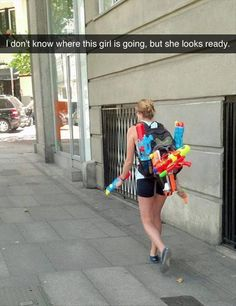 Dump A Day Funny Pictures Of The Day - 86 Pics. if you don't want to get wet, stay out of her way! water gun fight