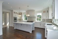 Kitchen.  Home.  Kitchen idea.  Home idea.  White kitchen.  Kitchen island.  Wood floors.  Window in kitchen.  Island.  Pendant lights.  Open kitchen.  Great kitchen.  Counter space.  Work space.  Cabinets.  Storage.  Drawers.  Built ins.