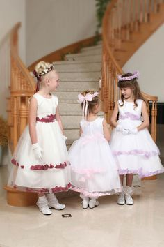 The ultimate flower girl dress!  Sleeveless princess style satin bodice with 2-tiered double layered full tulle skirt.  Matching tulle waist sash with loose petals that ties in back (side ribbon stays for keeping it in place).  Skirt has 'loose' flower petals all around with in both tiers.  Skirt has additional netting crinoline underneath that can be 'puffed' up if extra fullness is desired.  Fully lined, zipper back.   Don't see the color that you need?  Contact our cust...