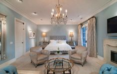 Tori Spelling's bedroom.  Good solution to a long room.  Create a seating area with a couch, glass coffee table, two arm chairs and small glass table in between.