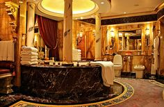 Look at that tub! Can you say gorgeous! Check out this websites. Most beautiful bathrooms.