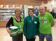 Southport Oxfam Group bag packing in Morrisons, with staff member.