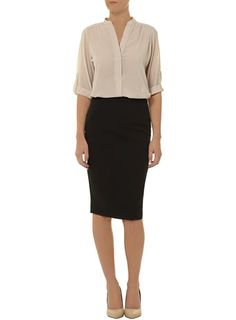 Like a good pair of slacks, everyone needs at least one black pencil skirt for their closet.