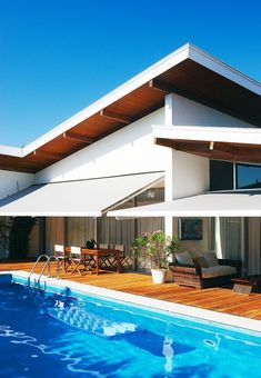 Home with modern architecture, an outdoor patio and a pool