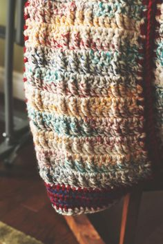 Faux Cable Crochet Blanket Pattern | Thick textured yarn and warm earth tone color scheme--what more do you need from a free crochet afghan pattern?