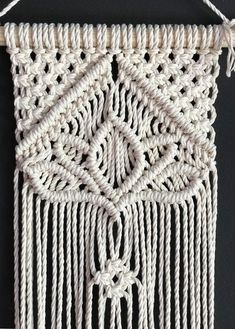 - · Moderm mini macrame wall hanging handmade of twisted cotton rope on a wooden stick. Unusual for wall hangings macrame floral pattern - the lotus in the center gives this wall hanging a charm and… Macrame Wall Hanger, Macrame Wall Hanging Patterns, Macrame Art, Macrame Projects, Macrame Modern, Free Macrame Patterns, Crochet Projects, Arm Knitting, Cotton Rope