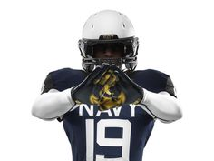 The gloves that Navy players will be wearing for the Army-Navy Game presented by USAA. NIKE footwear © 2013 jim golden all rights reserved