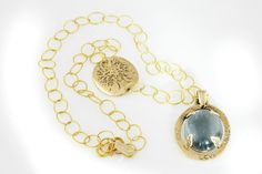 Magic Sea necklace: Blue tourmaline hand cut, 18k yellow chain with 14k. yellow gold charms. Limited edition.