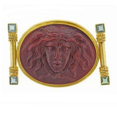 For Sale on - From acclaimed jeweler, Elizabeth Locke this 19 Karat carved burgundy glass cameo brooch depicting the head of medusa of Greek mythology. The oval cameo Cameo Pendant, Pearl Pendant, Perseus And Medusa, Aquamarine Pendant, Aquamarine Earrings, Gold Brooches, Vintage Brooches, Victorian Gold, Coral And Gold