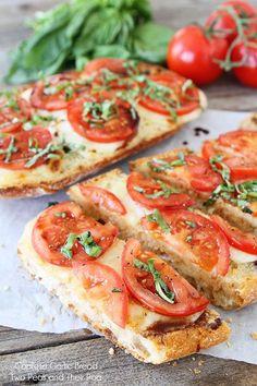Caprese Garlic Bread Recipe on www.twopeasandtheirpod.com The best garlic bread ever!  #caprese #recipe #garlicbread